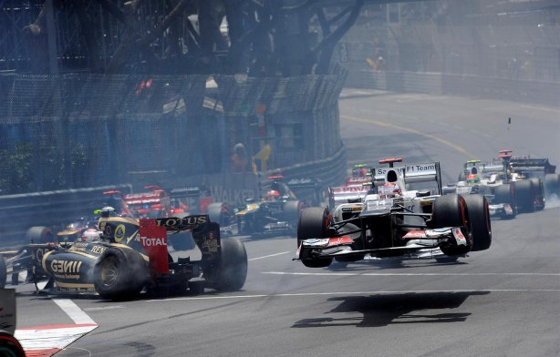 Romain-Grosjean-FRA-Lotus-E20-and-Kamui-Kobayashi-JPN-Sauber-C31-crash-out-at-the-start-of-the-race.-Formula-One-World-Championship-Rd6-Monaco-Grand-Prix-Race-Day-Monte-Carlo-Monaco-Sunday-27-May-2012